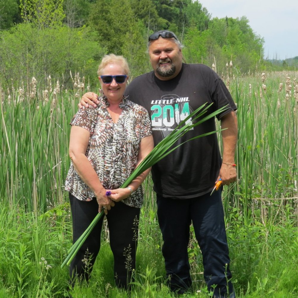 Annie with Chief Greg Cowie harvesting rushes